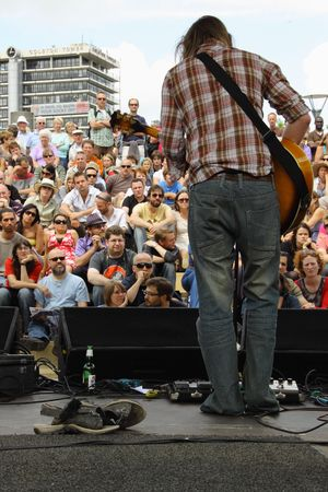 Bristol, England - August 2, 2009 - Guitarist out front on the Cascade Steps stage during the annual Harbour Festival, the largest free event of its kind in Europe, attended by 250,000 people over three days Stock Photo - 6885480
