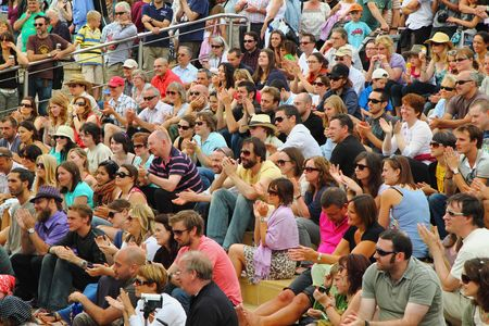 Bristol, England - August 2, 2009 - A happy audience at the Cascade Steps stage shows its appreciation for one of the bands at the annual Harbour Festival. Over three days 250,000 people attended the free event, the largest of its kind in Europe