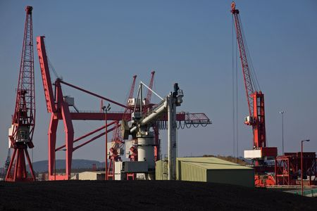 shipload: Dockside Machinery and Unloaded Imported Coal at Avonmouth UK