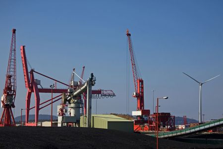 shipload: Coal Store and Wind Turbine Represent Alternative Energy Sources at Avonmouth UK