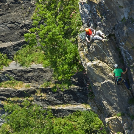 reliance: Bristol, England - June 20, 2010 - Climbers on a rock face in the Avon Gorge. The mutual reliance of the participants in this hazardous pastime is self-evident. Editorial