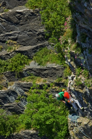 rely: Bristol, England - June 20, 2010 - Climbers on a rock face in the Avon Gorge. The mutual reliance of the participants in this hazardous pastime is self-evident. Editorial