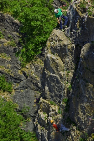 Bristol, England - June 20, 2010 - Climbers on a rock face in the Avon Gorge. The mutual reliance of the participants in this hazardous pastime is self-evident.