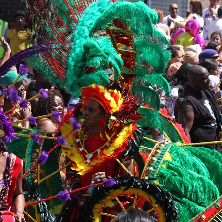 """exuberance: Bristol, England - July 3, 2010 - Participant and crowd at the annual St Pauls """"Afrikan-Caribbean"""" carnival. A record 70,000 people attended the 42nd running of the community event"""