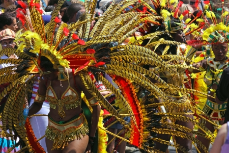 """Bristol, England - July 3, 2010 - Participant and crowd at the annual St Pauls """"Afrikan-Caribbean"""" carnival. A record 70,000 people attended the 42nd running of the community event"""