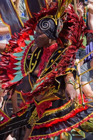 """Bristol, England - July 3, 2010 - Participant in the annual St Pauls """"Afrikan-Caribbean"""" carnival. A record 70,000 people attended the 42nd running of the community event"""