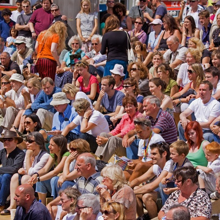 Bristol, England - August 1, 2010 - Crowd awaiting a performance on the Cascade Steps stage at the citys annual Harbour Festival