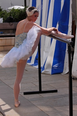 Bristol, UK - July 31, 2010 - Megan Fairchild of the New York City Ballet performs stretches prior to dancing Swan Lake at the annual Harbour Festival attended by 250,000 people over three days Editorial