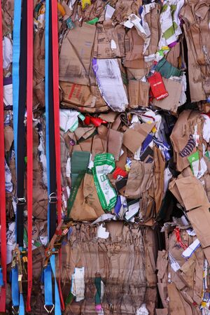 Bristol, UK - February 3, 2011 : Cardboard stacked on a wagon prior to processing at a recycling plant Stock Photo - 8724342