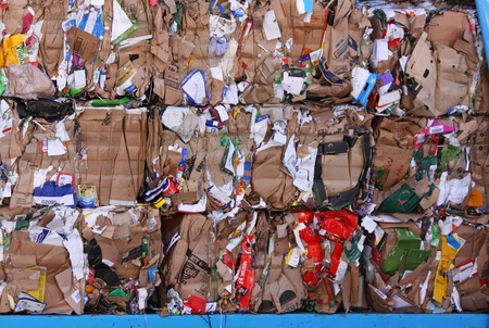 Bristol, UK - February 3, 2011 : Cardboard stacked on a wagon prior to processing at a recycling plant Stock Photo - 8724343