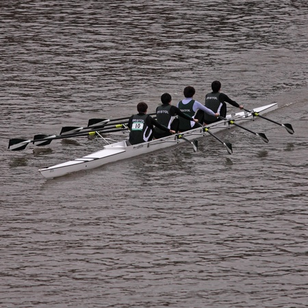 propellant: Bristol,UK - February 20, 2011 : A team racing in the annual Head of the River race in the city's docks. Some 150 crews entered the 3,300 metre race