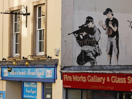 subversion: Bristol,UK - February 20, 2011 : Graffiti by  Banksy in the centre of his native Bristol