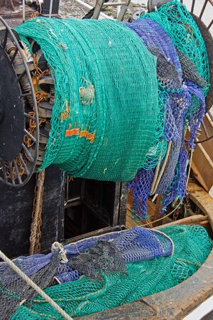 Fishing nets gathered at the stern of a trawler photo