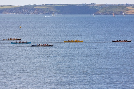 Teams competing in the Falmouth Gig Club regatta off Cornwall, England on June 11, 2011