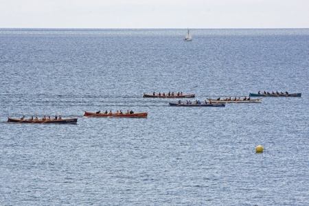 gig harbor: Teams competing in the Falmouth Gig Club regatta in Cornwall, England on June 11, 2011