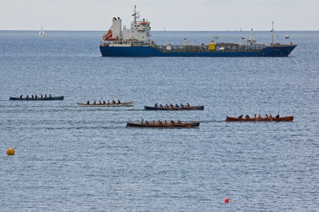 gig: A Cargo Ships races teams in the Falmouth Gig Club regatta in Cornwall, England on June 11, 2011