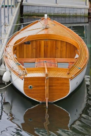 strict: Wooden rowboat in dock Stock Photo
