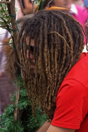 """Bristol, England - July 2, 2011 - Dreadlocked participant in the annual St Pauls """"Afrikan-Caribbean"""" carnival. A record crowd of 80,000 attended the event"""
