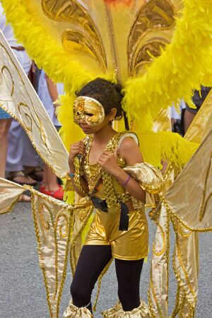 """Bristol, England - July 2, 2011 - Junior participant in the annual St Pauls """"Afrikan-Caribbean"""" carnival. A record crowd of 80,000 attended the street event Stock Photo - 9890758"""