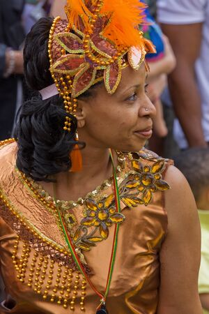 """Bristol, England - July 2, 2011 - Participant in the annual St Pauls """"Afrikan-Caribbean"""" carnival. A record crowd of 80,000 attended the street event"""