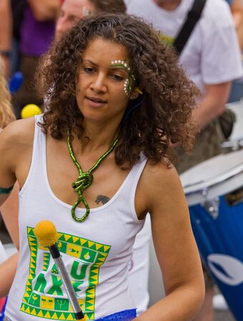 """Bristol, England - July 2, 2011 - Samba drummer at the annual St Pauls """"Afrikan-Caribbean"""" carnival. A record crowd of 80,000 attended the street event Stock Photo - 9890754"""