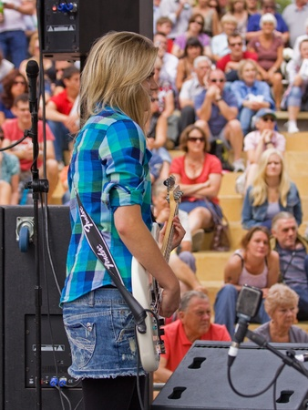 Bristol, England - July 30, 2011 - Young musician on stage at the 40th annual Harbour Festival attended by an estimated 280,000 people