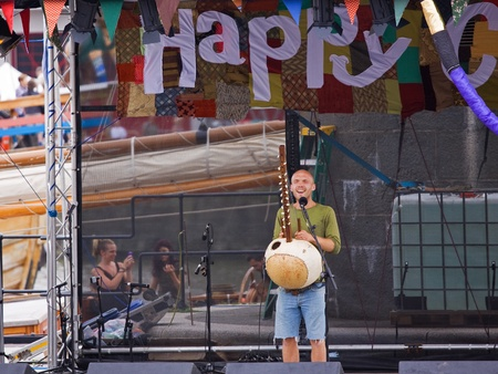Bristol, England - July 31, 2011 - Musician playing the kora on stage at the 40th annual Harbour Festival attended by an estimated 280,000 people