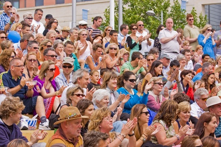 Bristol, England - July 31, 2011 - An audience applauds at the 40th annual Harbour Festival attended by an estimated 280,000 people