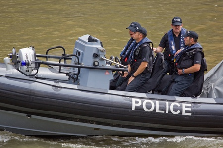 constabulary: Bristol, England - July 31, 2011 - Harbour police on patrol Editorial