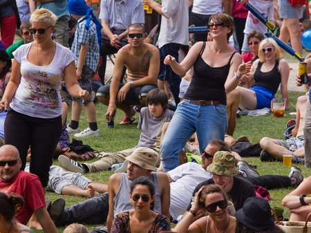 Bristol, England - July 31, 2011 - Dancing spectators at the 40th annual Harbour Festival attended by an estimated 280,000 people