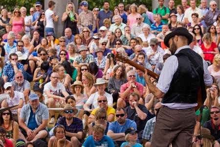 attended: Bristol, England - July 31, 2011 - Guitarist and audience at the 40th annual Harbour Festival attended by an estimated 280,000 people Editorial
