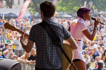 gig harbor: Bristol, England - July 30, 2011 - Guitarist backing soul singer Celestine at the 40th annual Harbour Festival, attended by an estimated 280,000 people