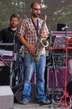 gig harbor: Bristol, England - July 31, 2011 - Saxophonist in the Pete Josef band performing at the 40th annual Harbour Festival attended by 280,000 people Editorial