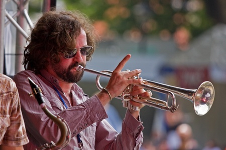 gig harbor: Bristol, England - July 31, 2011 - Trumpeter in the Pete Josef band performing at the 40th annual Harbour Festival attended by 280,000 people