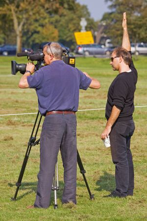 footage: Bristol, England - September 1, 2011 : Members of  an outside broadcast team recording a report for television
