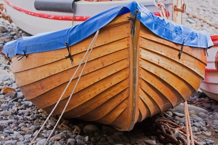 clinker: Beached dinghy   Stock Photo
