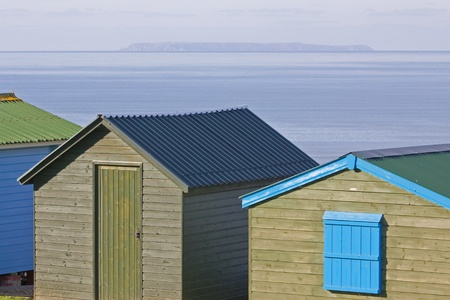 bristol channel: Seaside huts overlooking Lundy island in the Bristol Channel UK