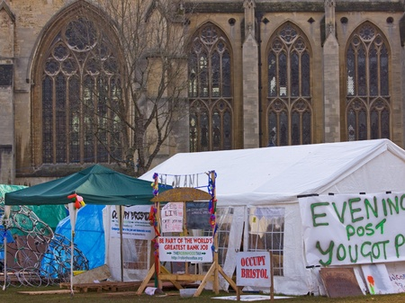 anti capitalist: Bristol, England - November 18, 2011 - The Occupy Bristol campaign in the shadow the Cathedral, the largest such camp in the UK outside London Editorial
