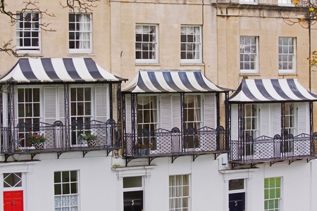 Striped Canopies over the Balconies of Georgian Townhouses in Bristol UK Stock Photo - 11441457