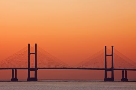Bridge over the river Severn between England and Wales in twilight photo