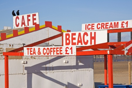 Refreshment signs on a deserted beach in winter sunshine photo