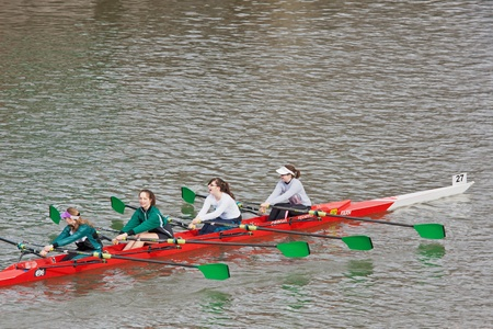Bristol, England � February 19, 2012 -  Four woman crew competing in the annual Head of the River race through the city docks entered by one hundred teams  Stock Photo - 12299578