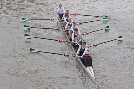 Bristol, England – February 19, 2012 -  Eight man crew competing in the annual Head of the River race through the city docks entered by one hundred teams    Stock Photo - 12299579