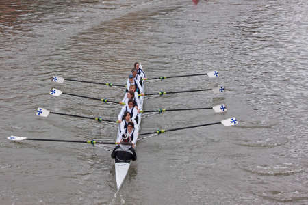 Bristol, England – February 19, 2012 - Female crew competing in the annual Head of the River race through the city docks entered by one hundred teams Stock Photo - 12465848
