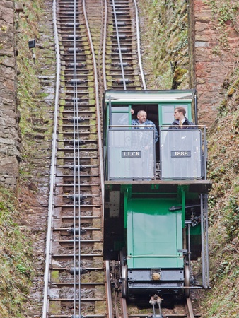 lynmouth: Lynton, England � March 6, 2012 -  Carriage with driver and passenger on the funicular railway linking Lynton and Lynmouth in Devon UK