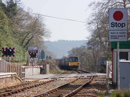 Passenger train on the approach to Eggesford station in Devon, England on March 24, 2012
