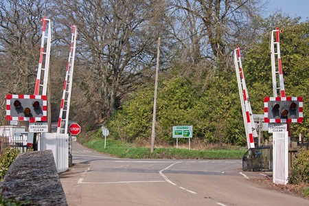 Rural level crossing with automatic barrier system at Eggesford in mid-Devon UK photo