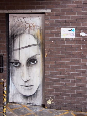 Bristol, England – May 2, 2012 : Painted doorway to an abandoned building in central Bristol painted for the 2011 See No Evil graffiti project