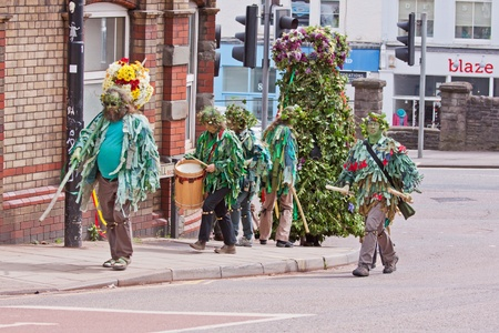 onset: Bristol, UK, 5th May, 2012. Attendants clad in rags ascend St Michaels Hill in Bristol, accompanying Jack in the Green, nine feet tall and covered in greenery and flowers. The medieval parade marking the onset of summer has recently been revived