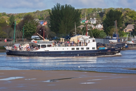 headway: Bideford, England May 12 - The MV Oldenburg makes its way up the Torridge estuary on a rising tide taking day-trippers to Lundy Island in the Bristol Channel